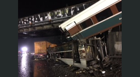 NTSB: Amtrak engineer missed speed-limit sign before train derailed